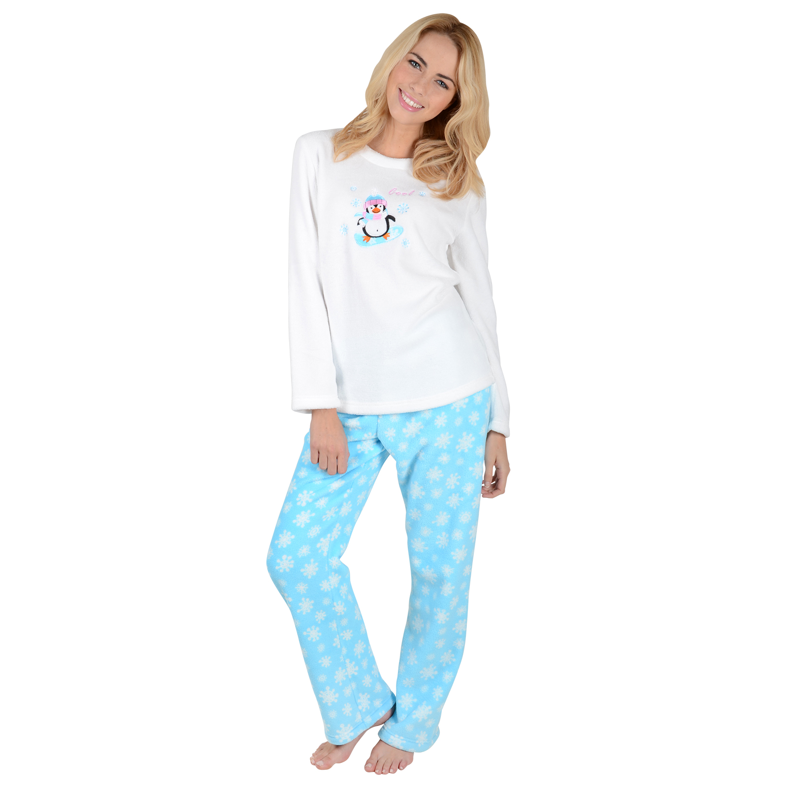 Peace on Earth Women's Pajamas. She'll love this charming twist on the classic Fair Isle pattern, featuring penguins, polar bears, snowflakes and trees that combine to make a wonderful winter print. Top is loose-fitting in Teal blue and details our exclusive Fair Isle print in a singular graphic.