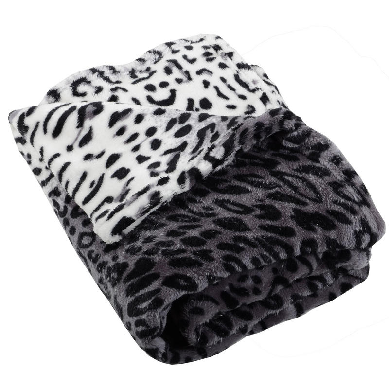 The sumptuous Mina Victory by Nourison SZ Reversible Throw is graced with a leopard print design on both sides and is trimmed i n flirty fringe trim. This throw comes in .