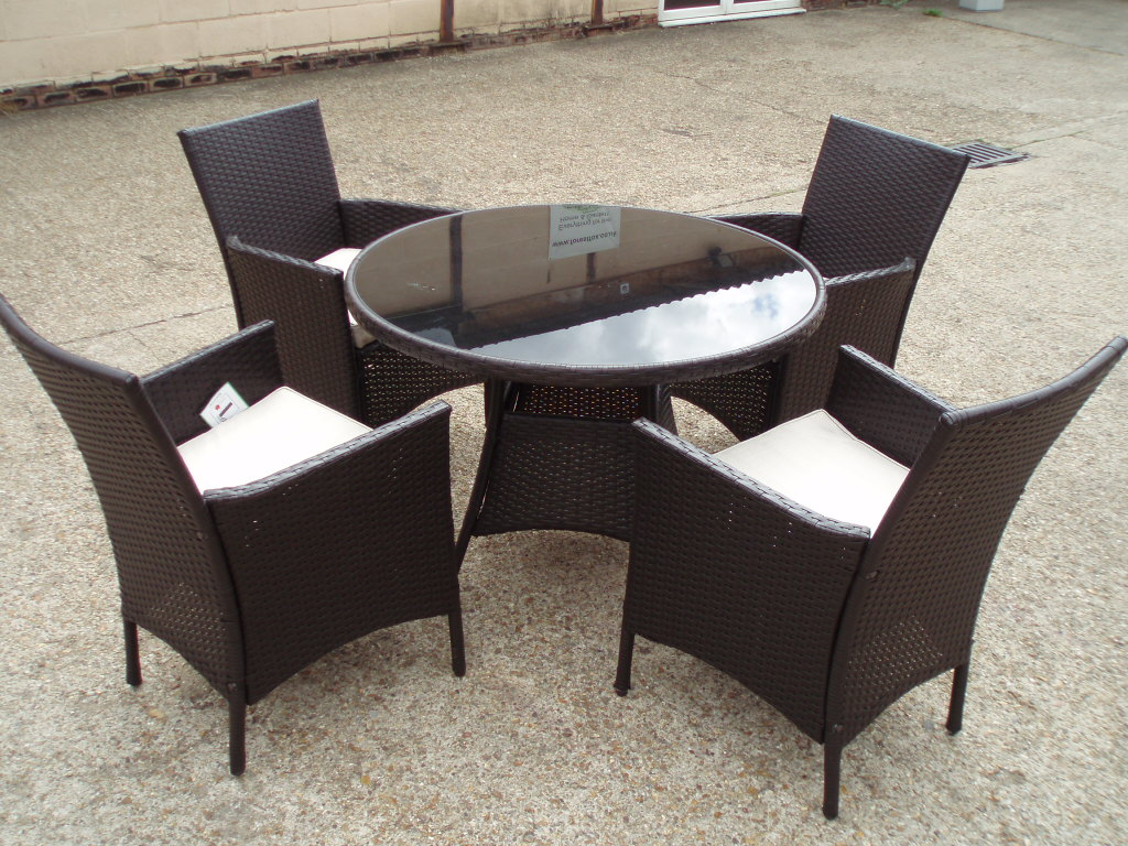 Rattan table 4 arm chairs cushions wicker round glass for Small patio table and 4 chairs