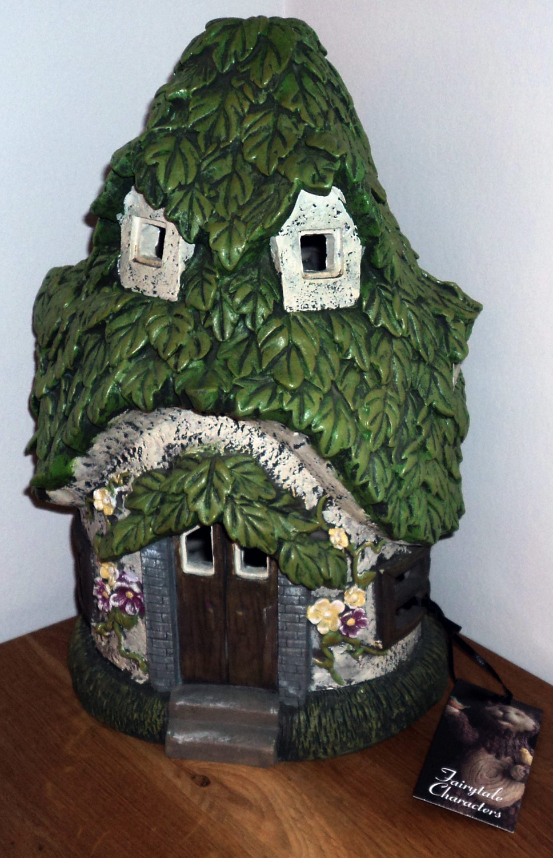 solar powered garden fairy house outdoor led fairies decor. Black Bedroom Furniture Sets. Home Design Ideas