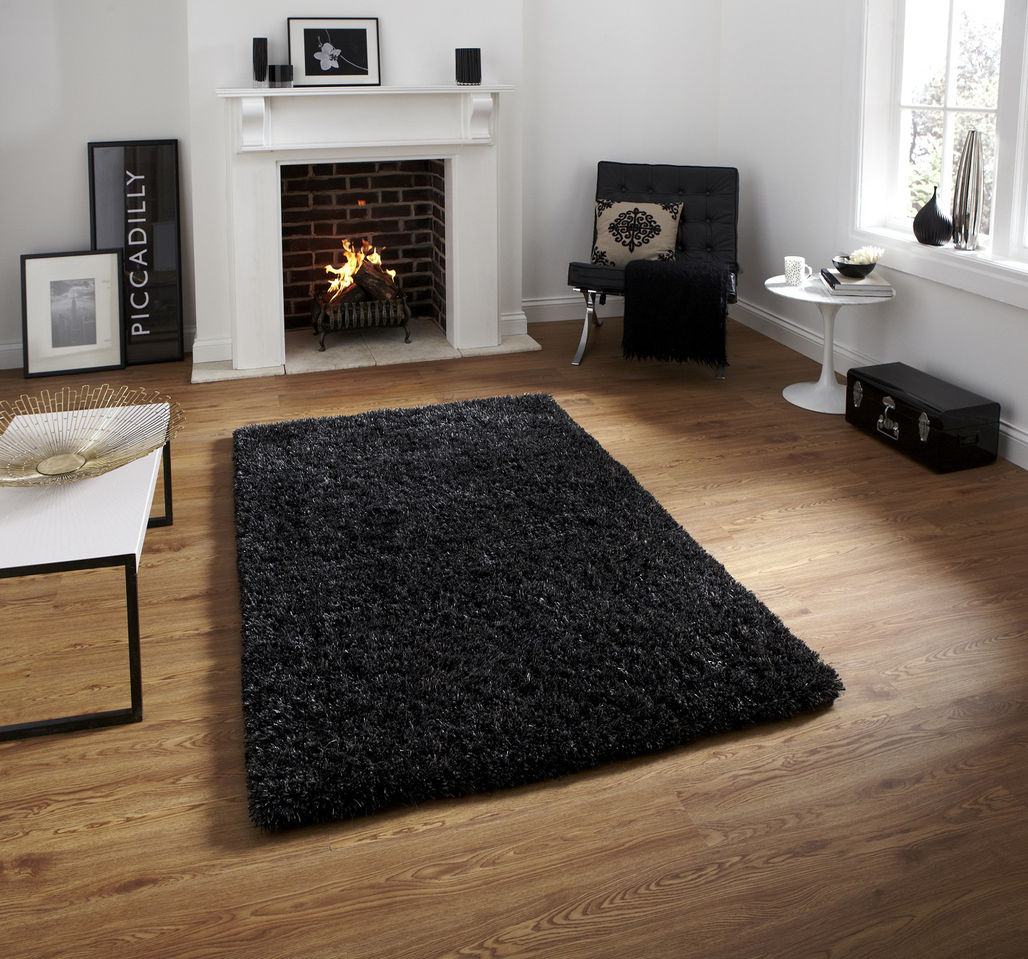 small livings rug table for living center black and room hardwood with floor floating tv rugs on near chair shelf stand media