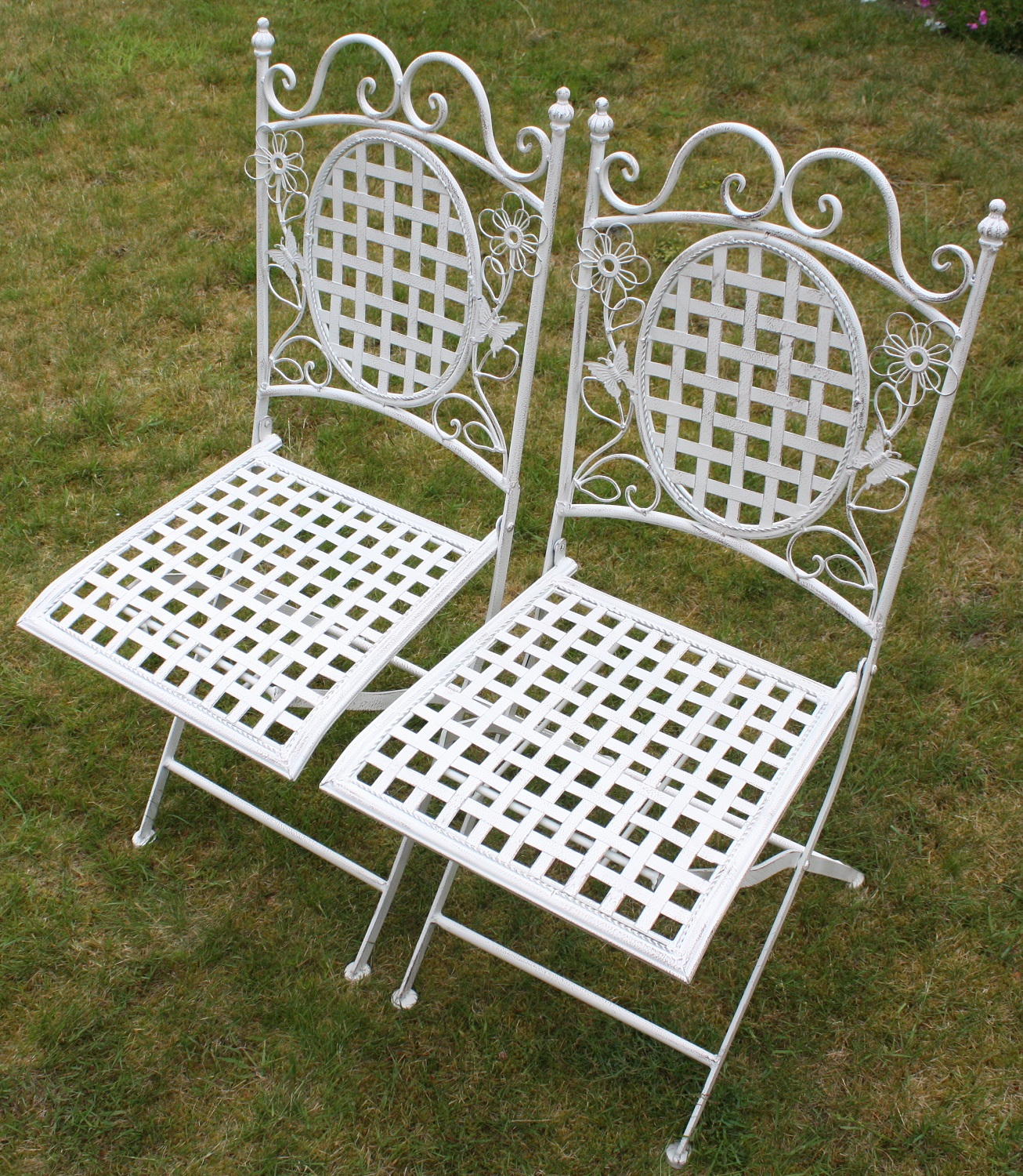 Two white floral outdoor folding metal square chairs for White outdoor furniture