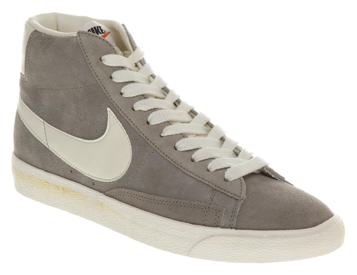 grey and white nike blazers