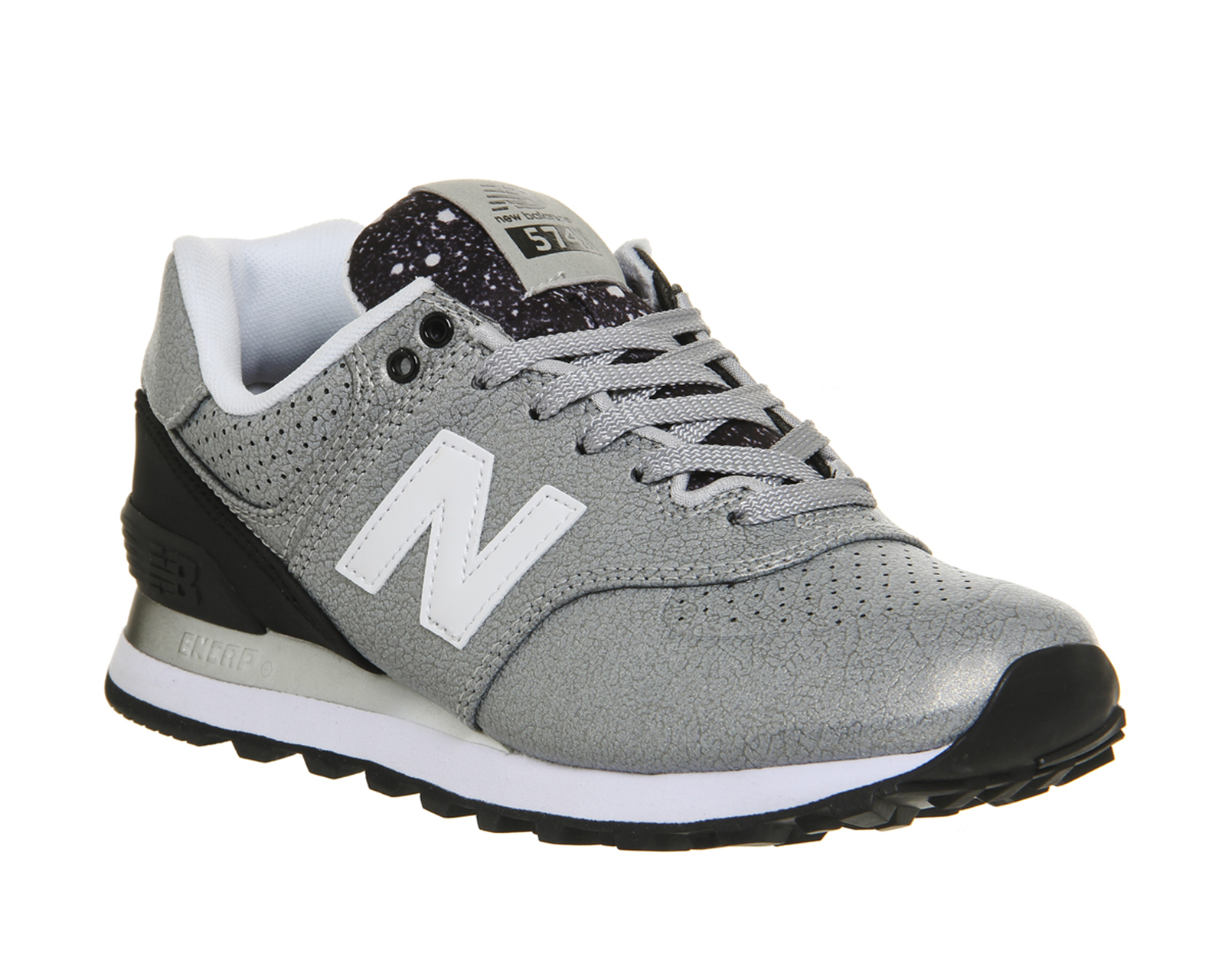 beige new balance trainers black and purple new balance