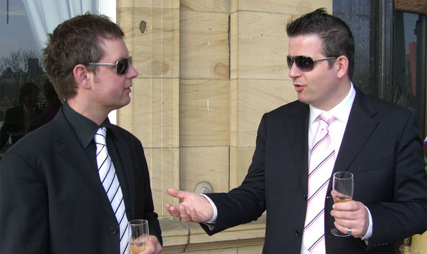 The groom and best man synchronising their sunglasses by Discounted sunglasses