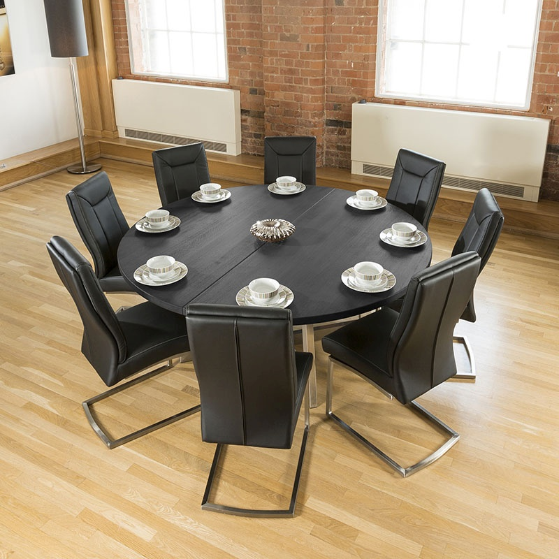 large round black oak dining table 8 deep vintage black chairs