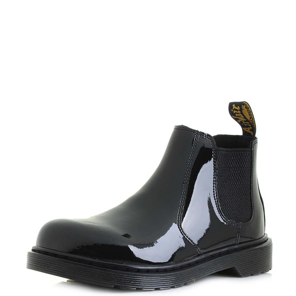Black Patent Block Heeled Ankle Boots A patent Chelsea boot is high on the most-coveted lists this season, and Kurt Geiger London has turned out a fine example in the new Raylan boot. Shaped in super-glossy black patent for a liquid effect, this style features tonal elasticated gussets at each side plus a back tab for total ease.