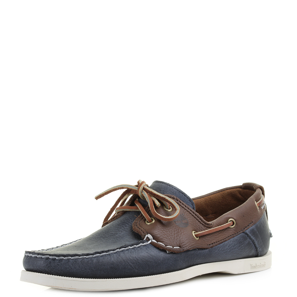 Darker leather boat shoes in tan or brown complement deep navy's, greys and blacks that are hallmarks of a business-casual aesthetic. Keep the cuffs on your chinos or tailored trousers rolled down and again, respect your colour combinations.