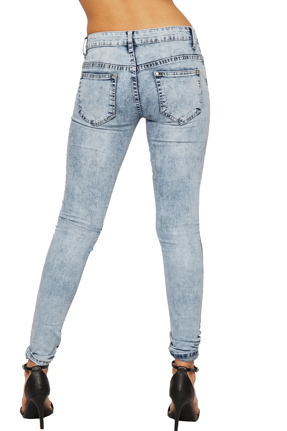 Wearing ripped jeans is a fine art, really. Done right, they look fashioned forward and cool—but one wrong tear and you're on your way to looking like Donnie Wahlberg during the New Kids on.