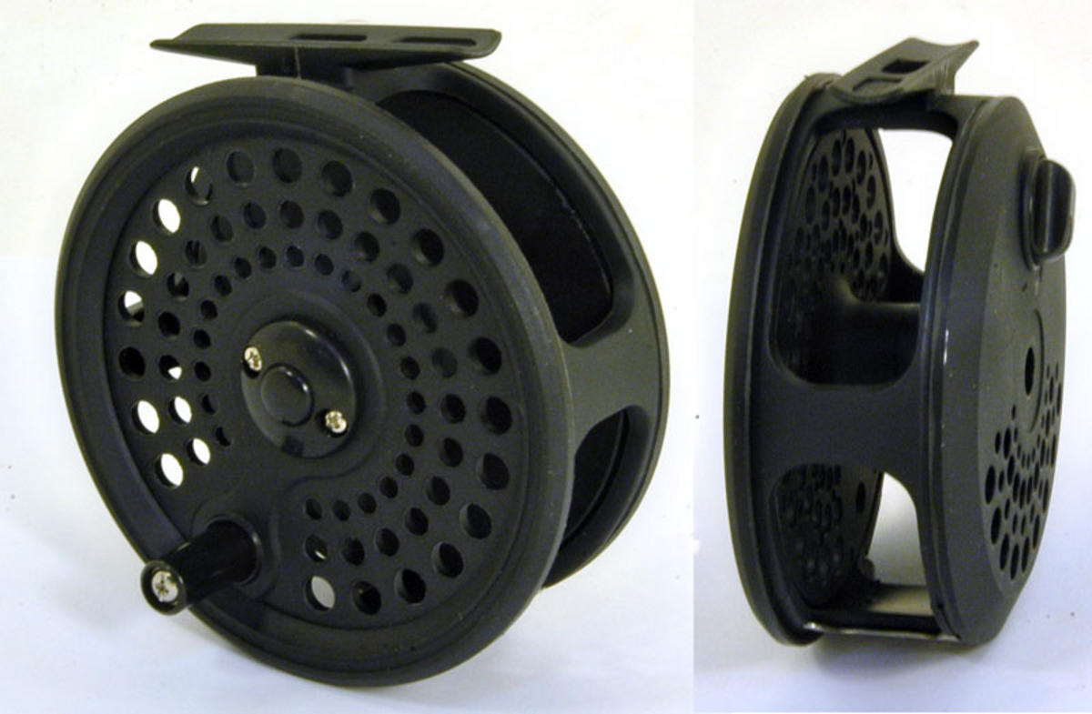 Brand new boxed graphite fly reel fly fishing mad for Fishing reel brands