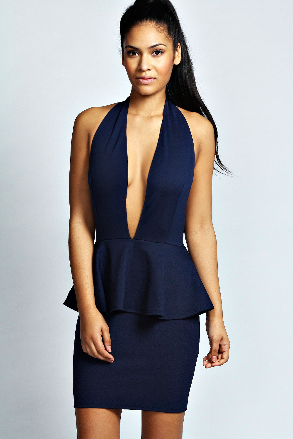 Online only! Shawl lapels outline the plunging neckline and lead into a bold halter strap, to give this beautiful bodycon dress a sophisticated touch! Crepe knit with some stretch hugs the body, leaving a sexy open back to dazzle from behind!Partially lined.