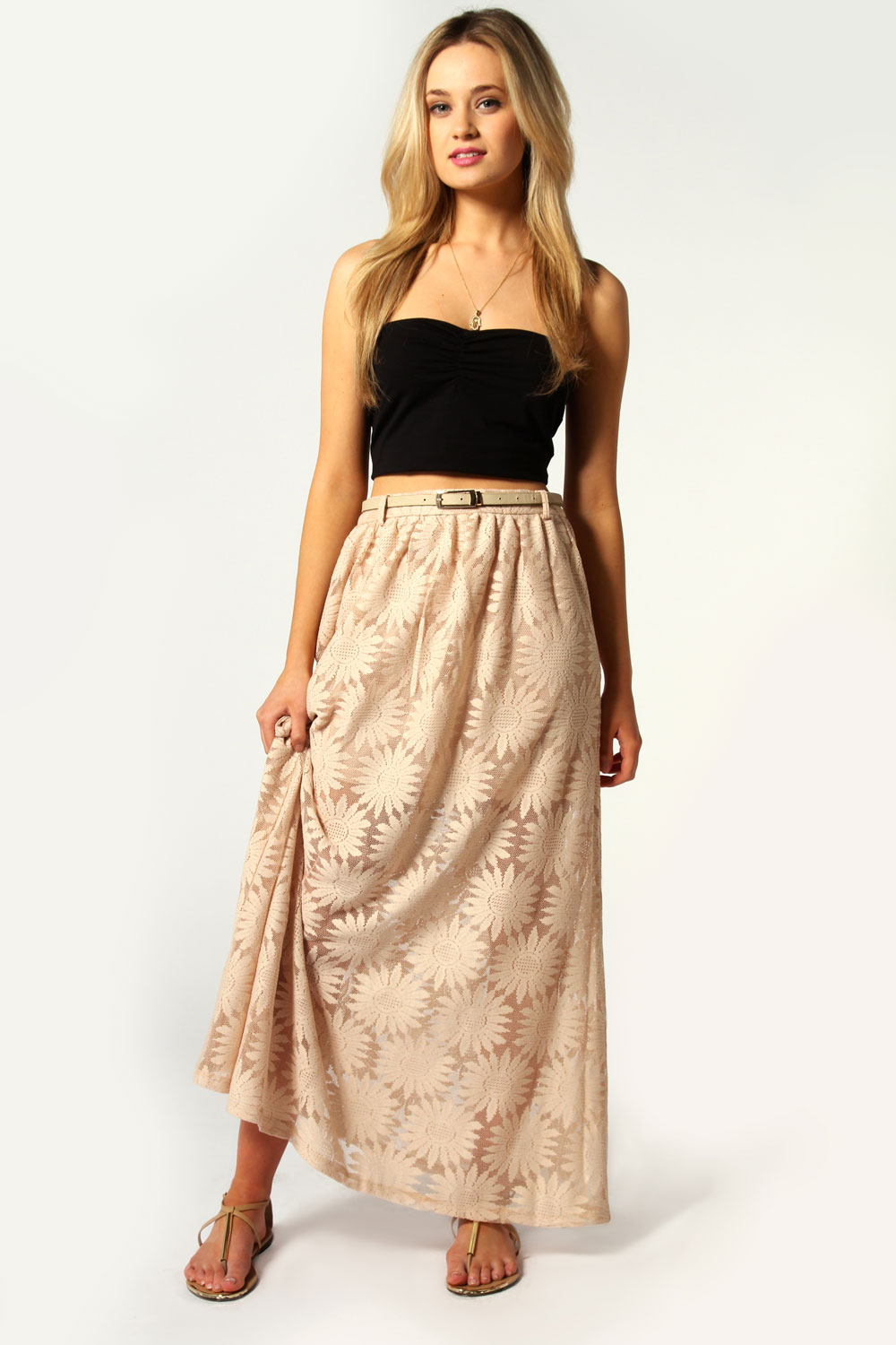 Heavy laced skirt trailered by next size Heavy black lace on top of a cream lining,is a line style knee length with back split and back 440v.cf excellent condition.