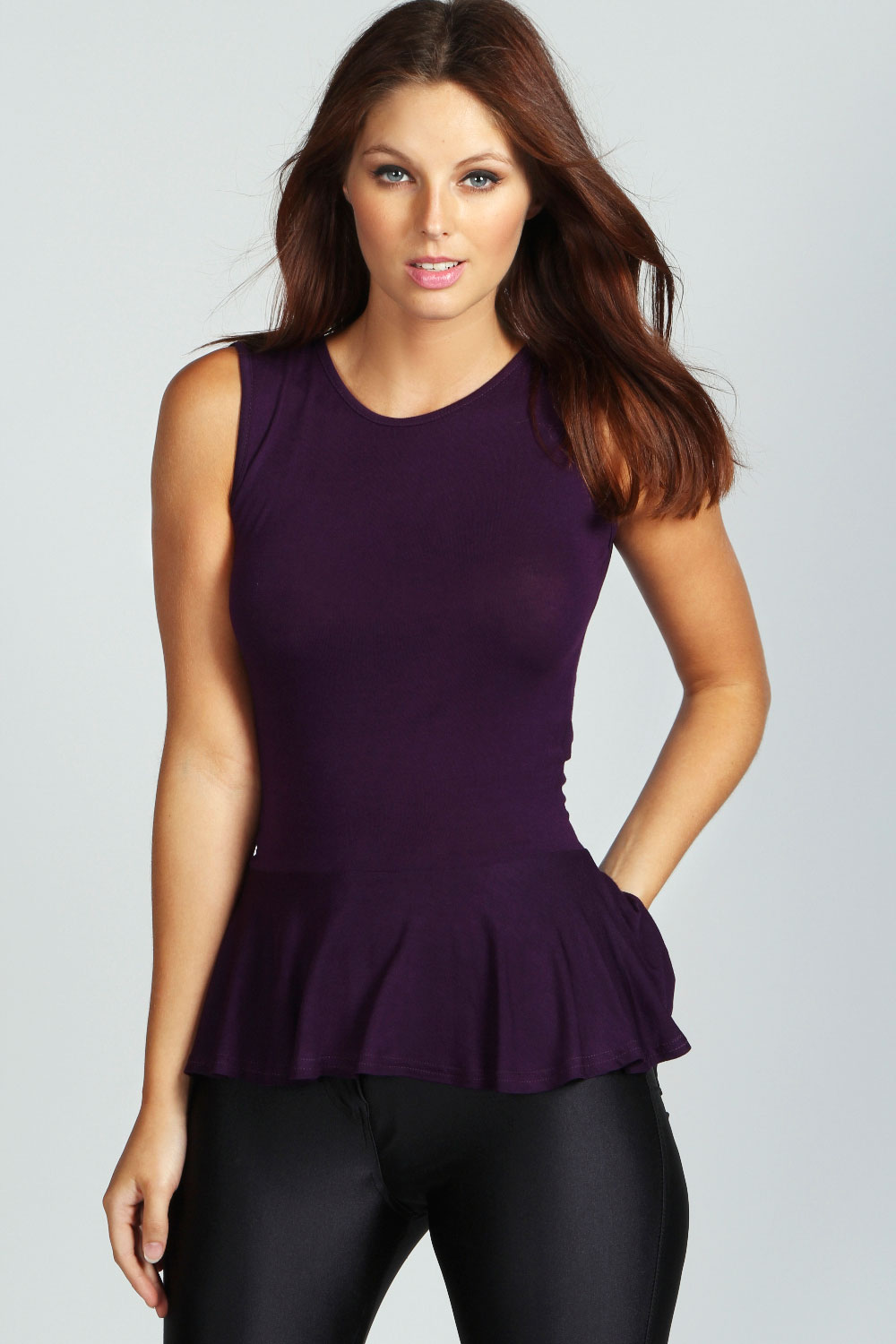 Charlotte Russe Open Back Peplum Top Textured crepe knit sculpts a striking top with charming details. This sleeveless top features a V-neckline, knotted detail and sexy open back.