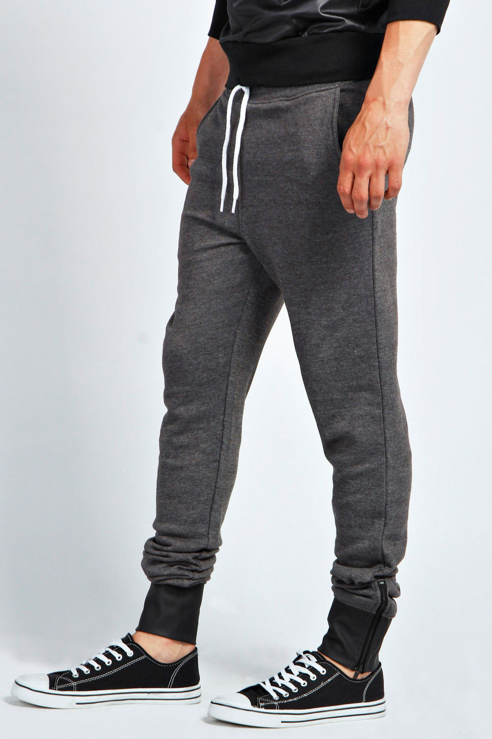 Product Features Slim Tapered Joggers with ankle zippers and 3 inch double seamed waistband.