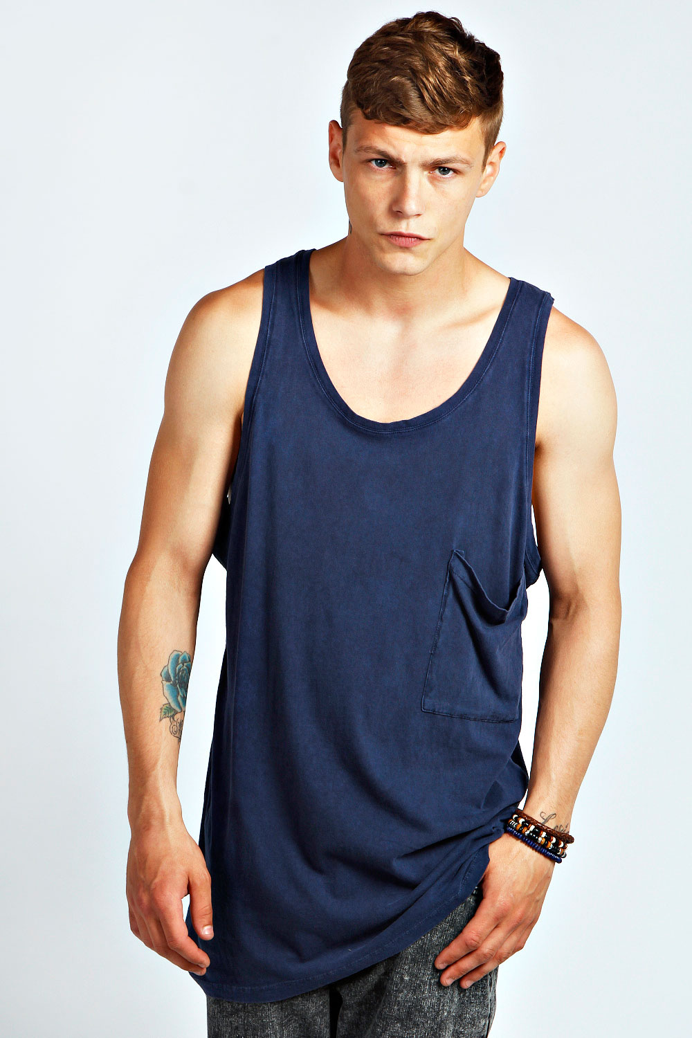 Update your basics this season with men's vests in staple shades and printed styles - perfect for the gym or layering under jumpers. Refresh your essentials with blue, white and red vests, easily paired with comfy shorts and sunglasses for added appeal. Think florals, stripes and colourblock vests to style your casual look, or simple shades of black and navy to wear under an open collar shirt.