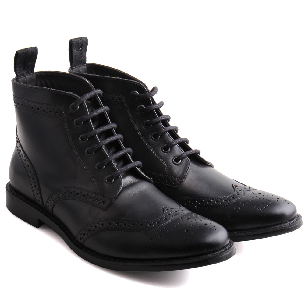 More Details Gucci Flat Queercore Lace-Up Leather Boots Details Gucci leather boot with pinked and brogue trim.