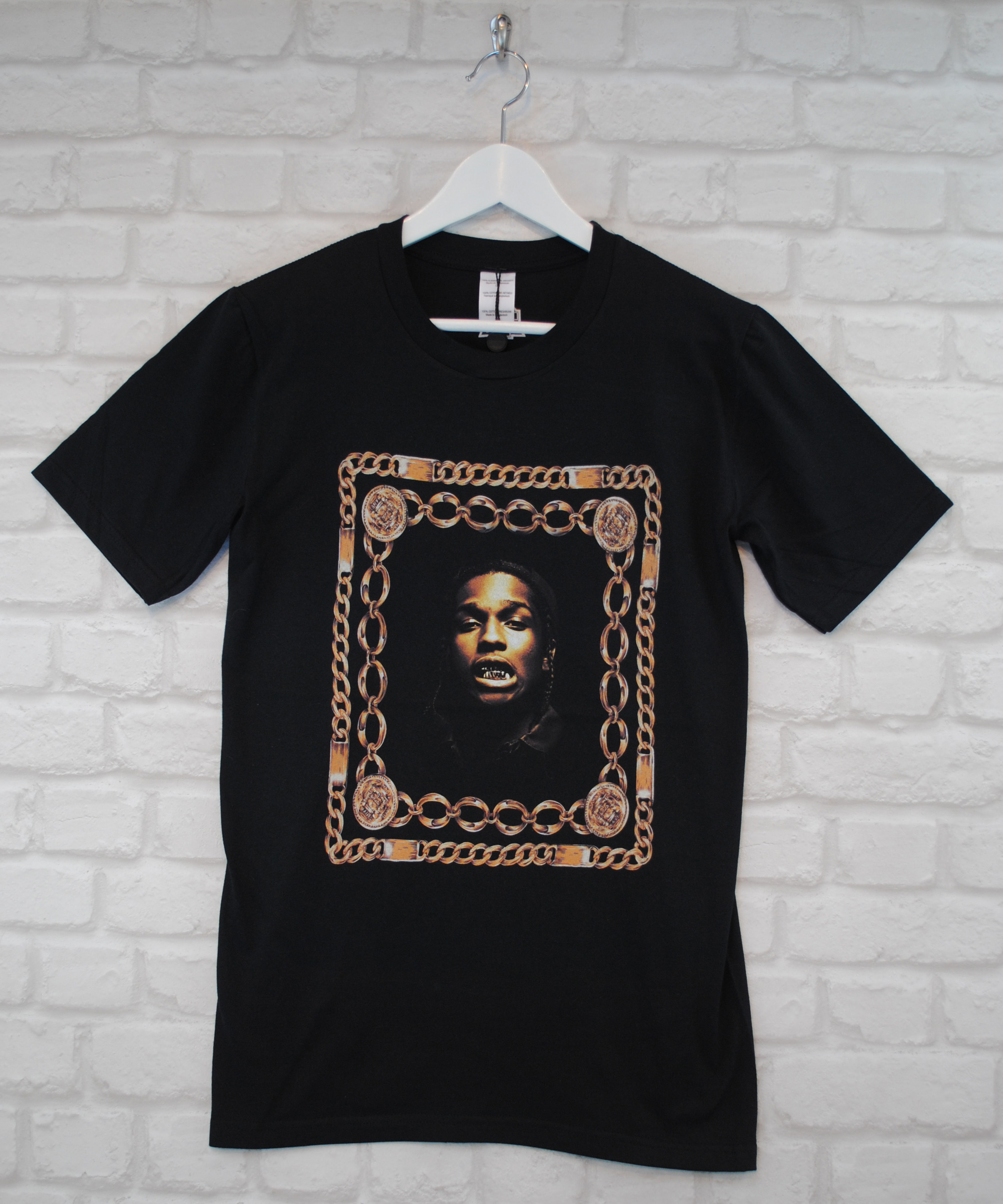 ASAP Rocky shirts come in a variety of styles, most often printed on black or white tees for a stark yet minimal look. These shirts may feature ASAP Rocky's logos, album art, or other images associated with the rapper, including photos or drawings.