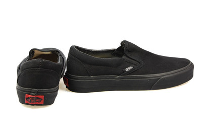 all black vans slip on