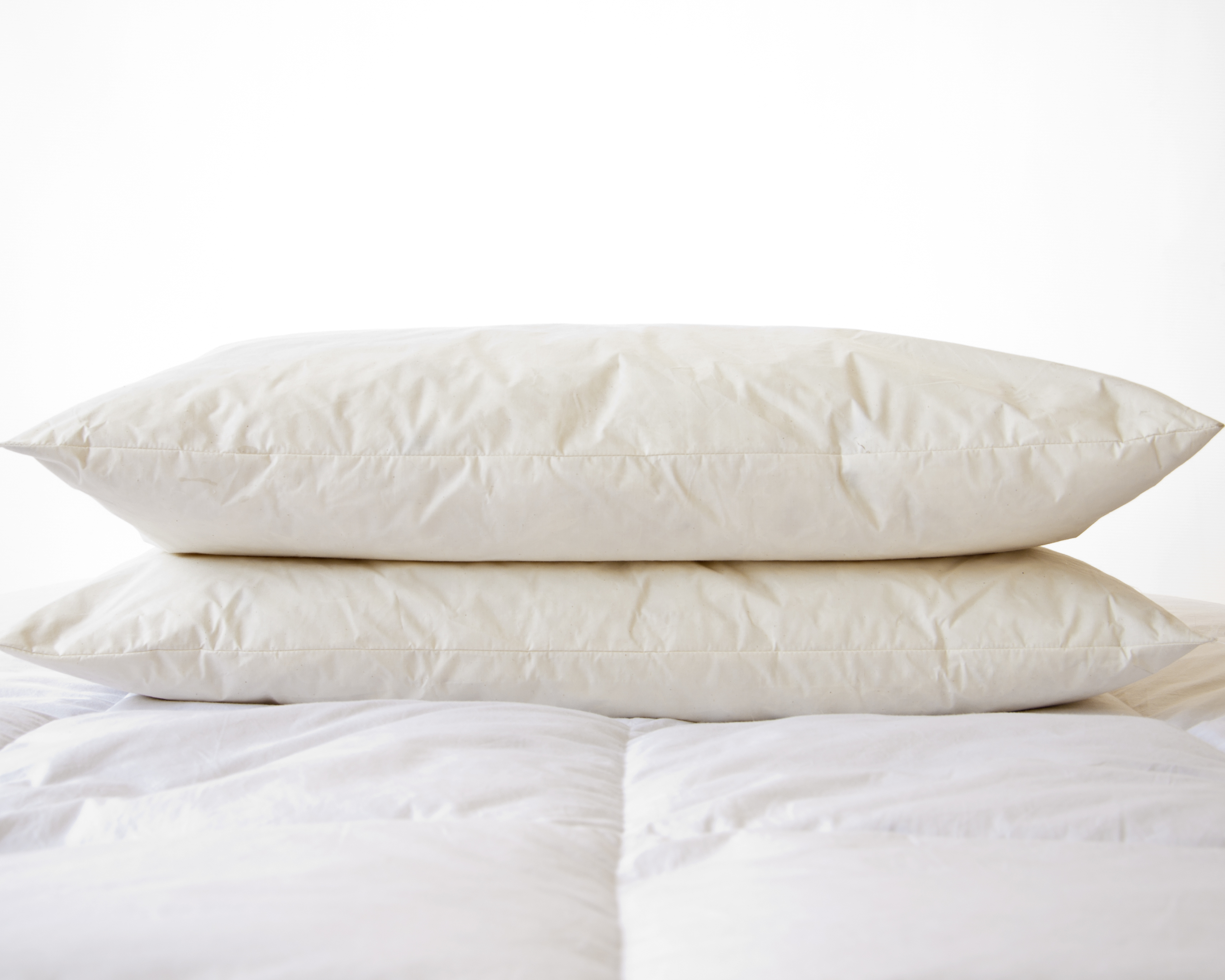 Old fashioned heavy feather pillows 65
