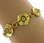 View Item Gold Tone Yellow Rhinestone Circle Link Bracelet
