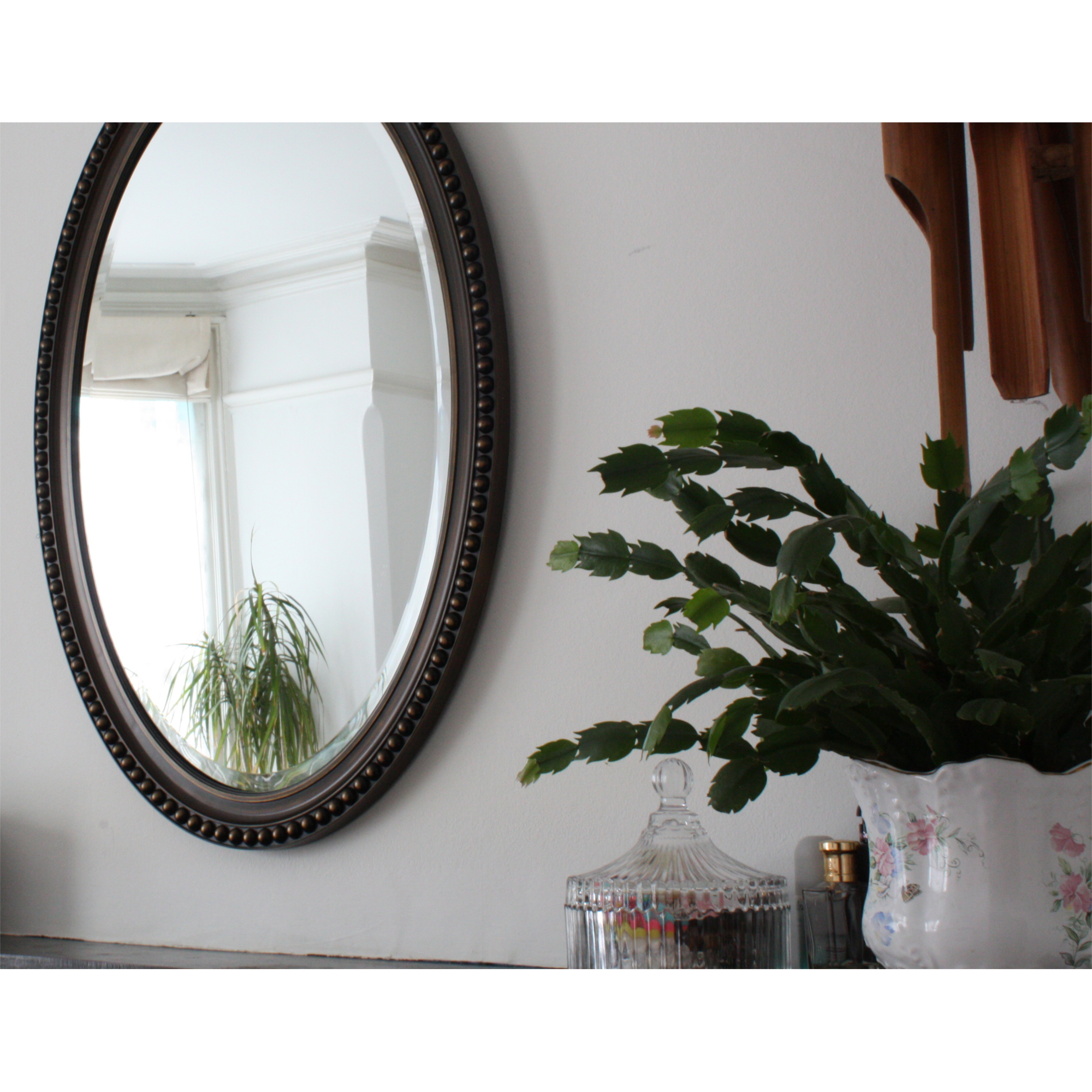 classic oval shaped hallway mirror champagne colouring blendboutique