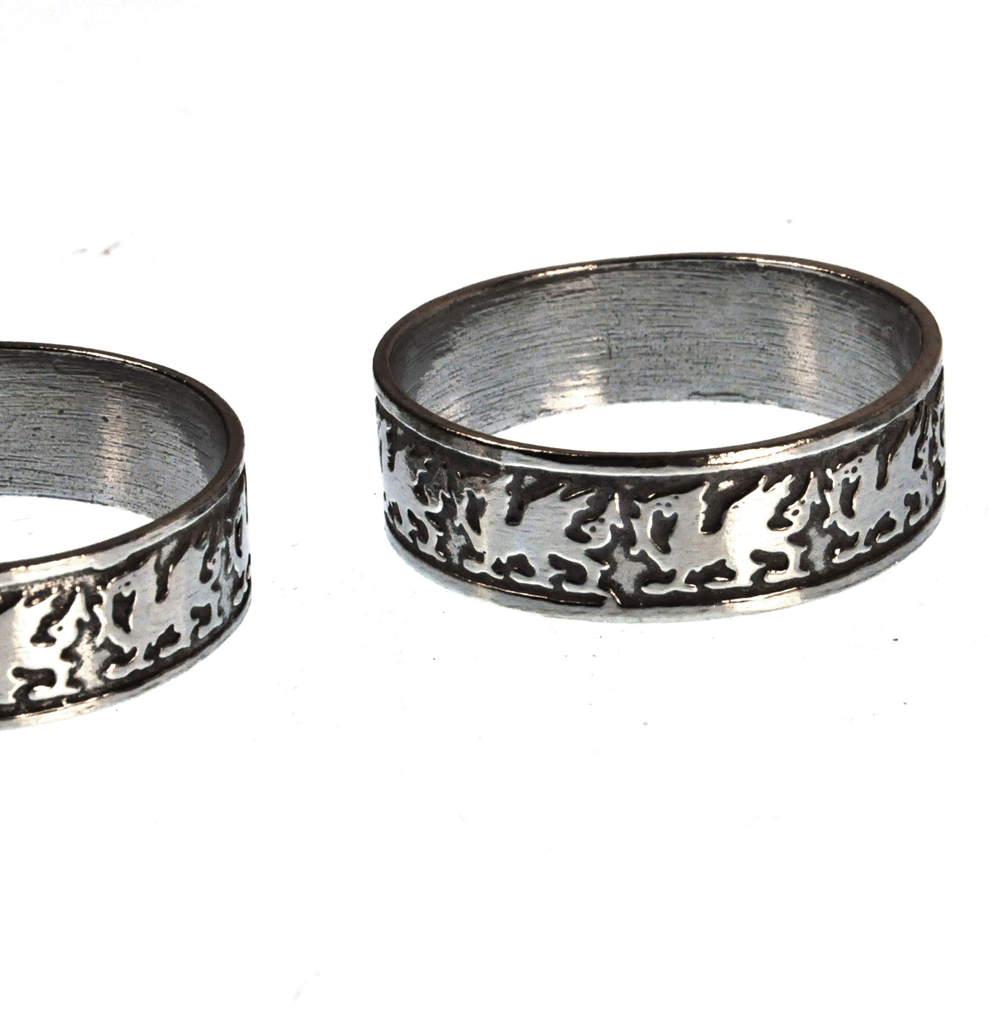 rings pair filigree metal round pewter