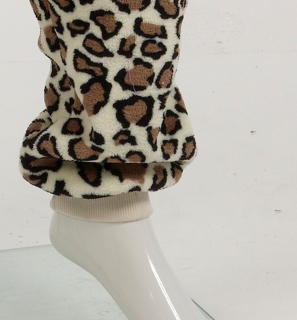 984ee9ffa0f These super soft fleece footless onesies have a leopard print design  throughout