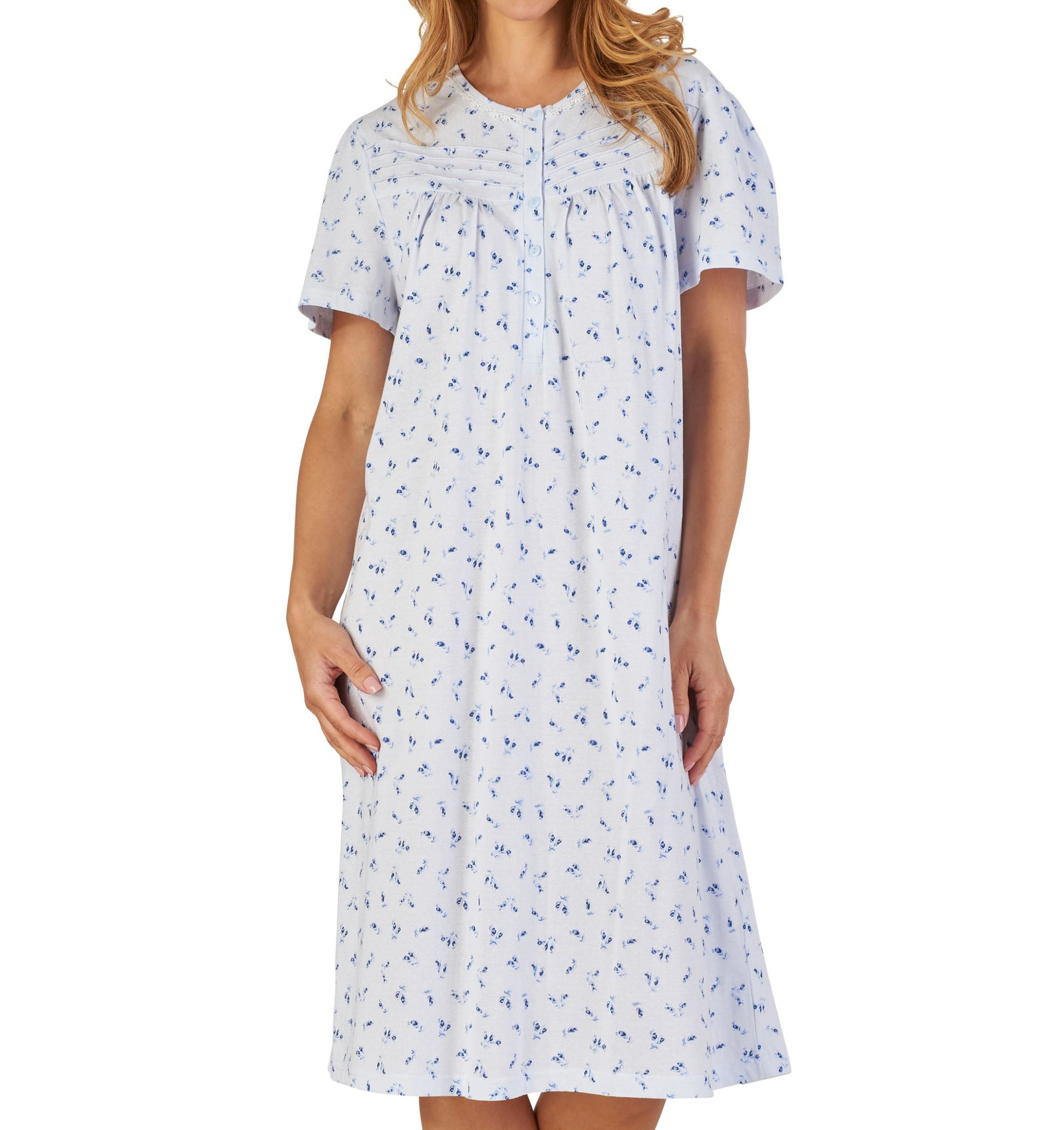 fd850aa216 This ladies nightdress by Slenderella has a classic floral and spot pattern  throughout with short sleeves and lace trim and would be perfect for  keeping you ...
