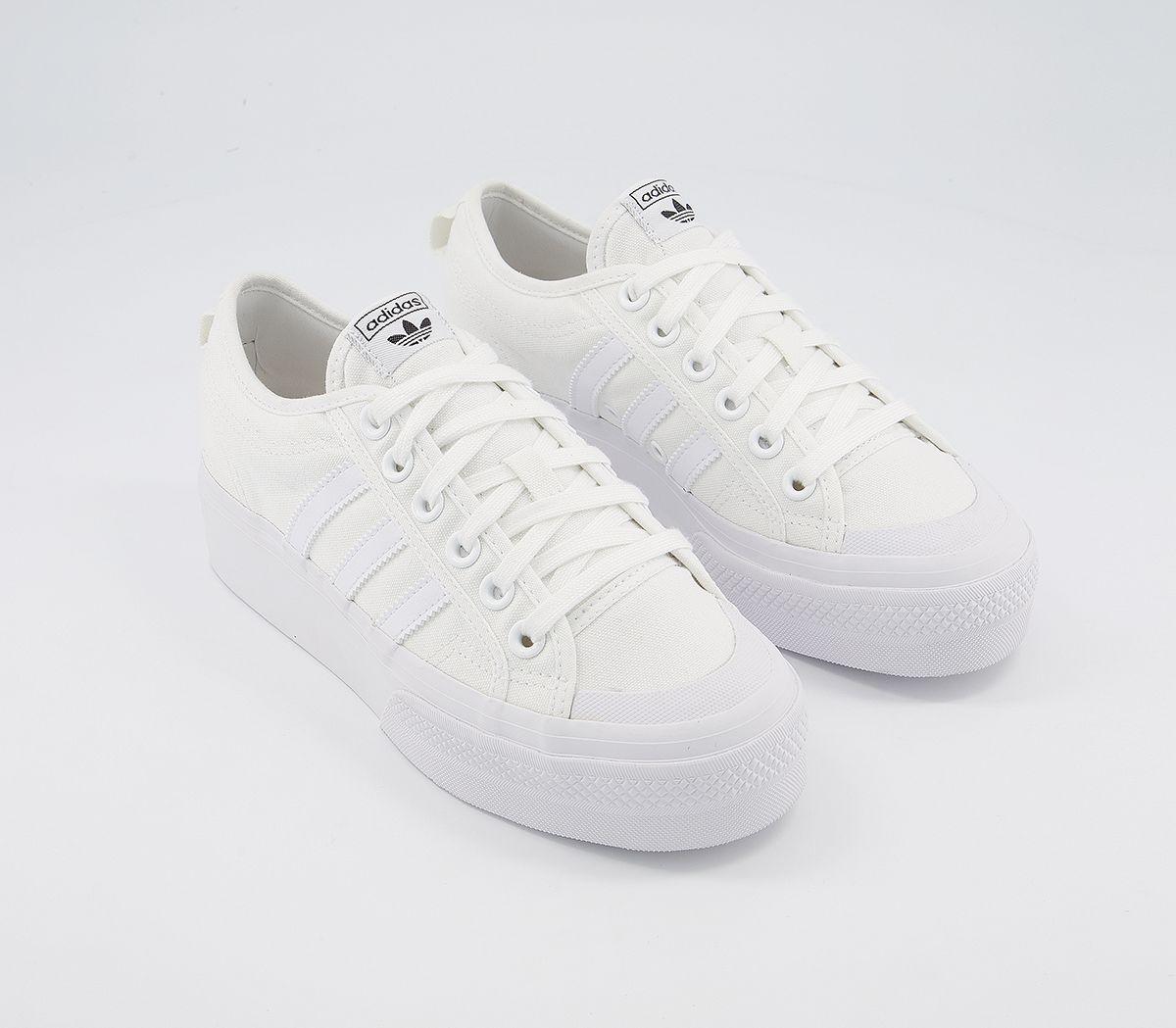 white adidas platform trainers