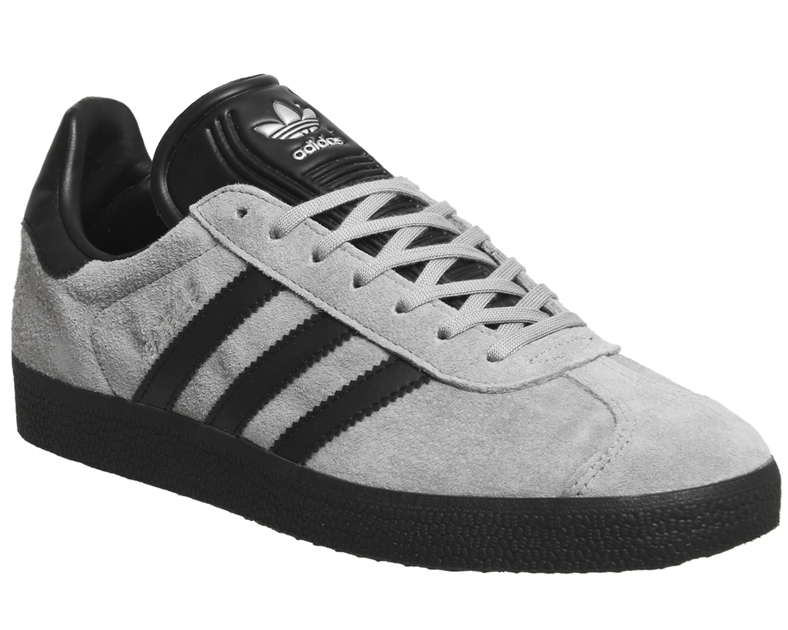 white leather adidas gazelle trainers