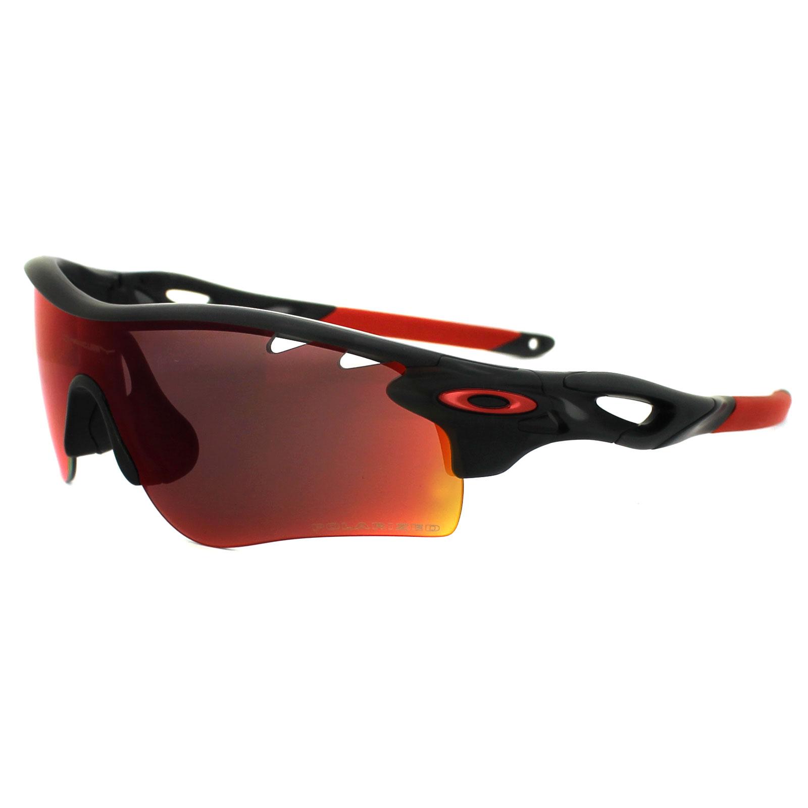 orange and black oakley sunglasses