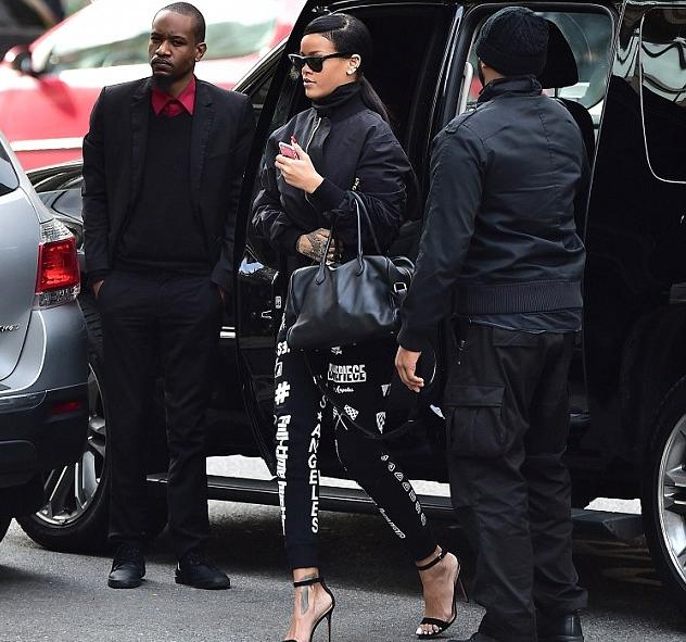 Rihanna wears her trusted Ray-Ban wayfarers