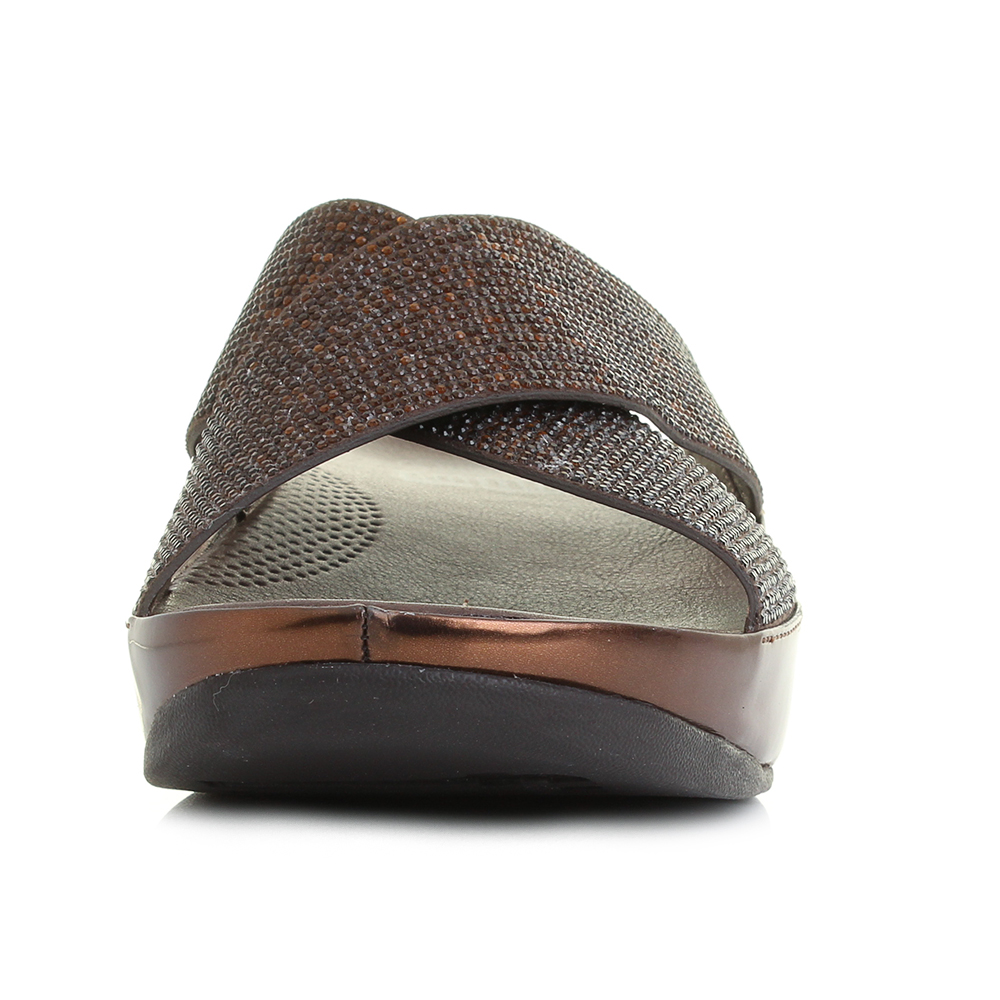8889307e2113 The Fit Flop Crystal Slide is a classic looking slip on sandal that has  been enhanced with the use of a full metallic bronze colour scheme and  glamorous ...