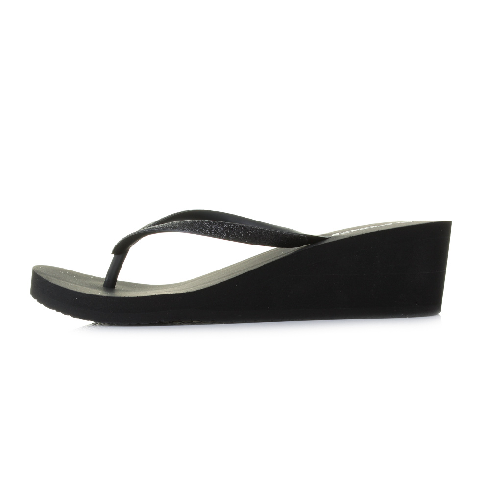 bb1e9dc25662d7 The Reef Krystal Star wedge flip flop is one of the brands most popular  fashion sandals. Featuring a wedge sole unit created from Reef s comfort  foam
