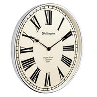 Endon Shelby oval wall clock chrome effect plate H: 495mm W: 415mm Proj: 50mm