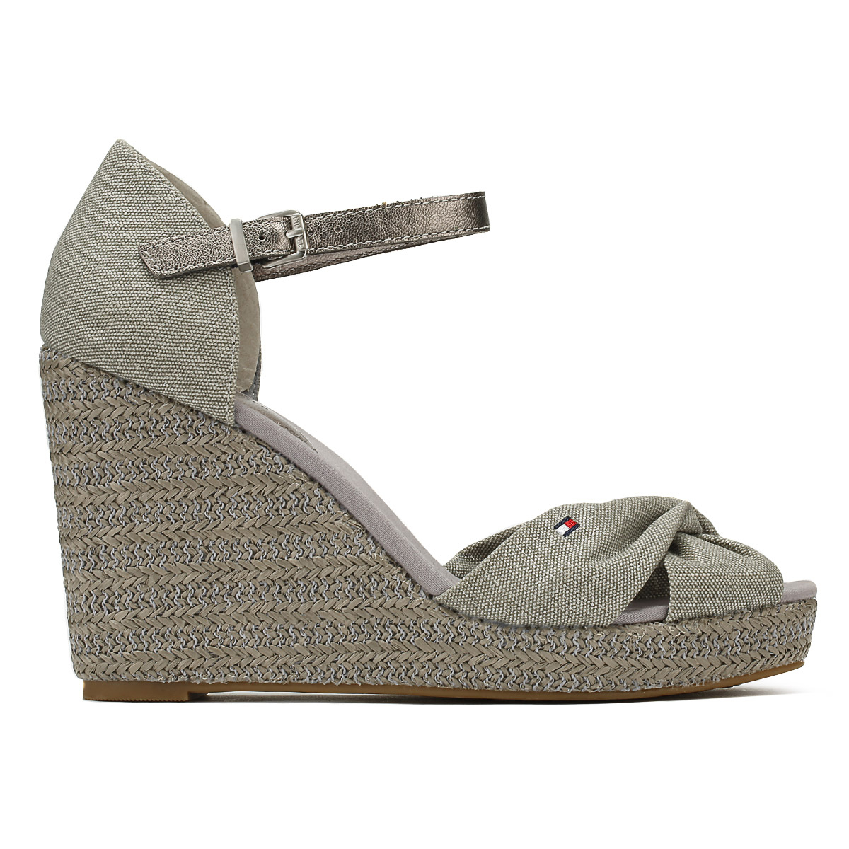 0e29f8822f7 Complete with a Tommy Hilfiger logo situated on the toe strap and  adjustable ankle strap with a silver-toned buckle. • Tonal metallic  materials • TPR ...