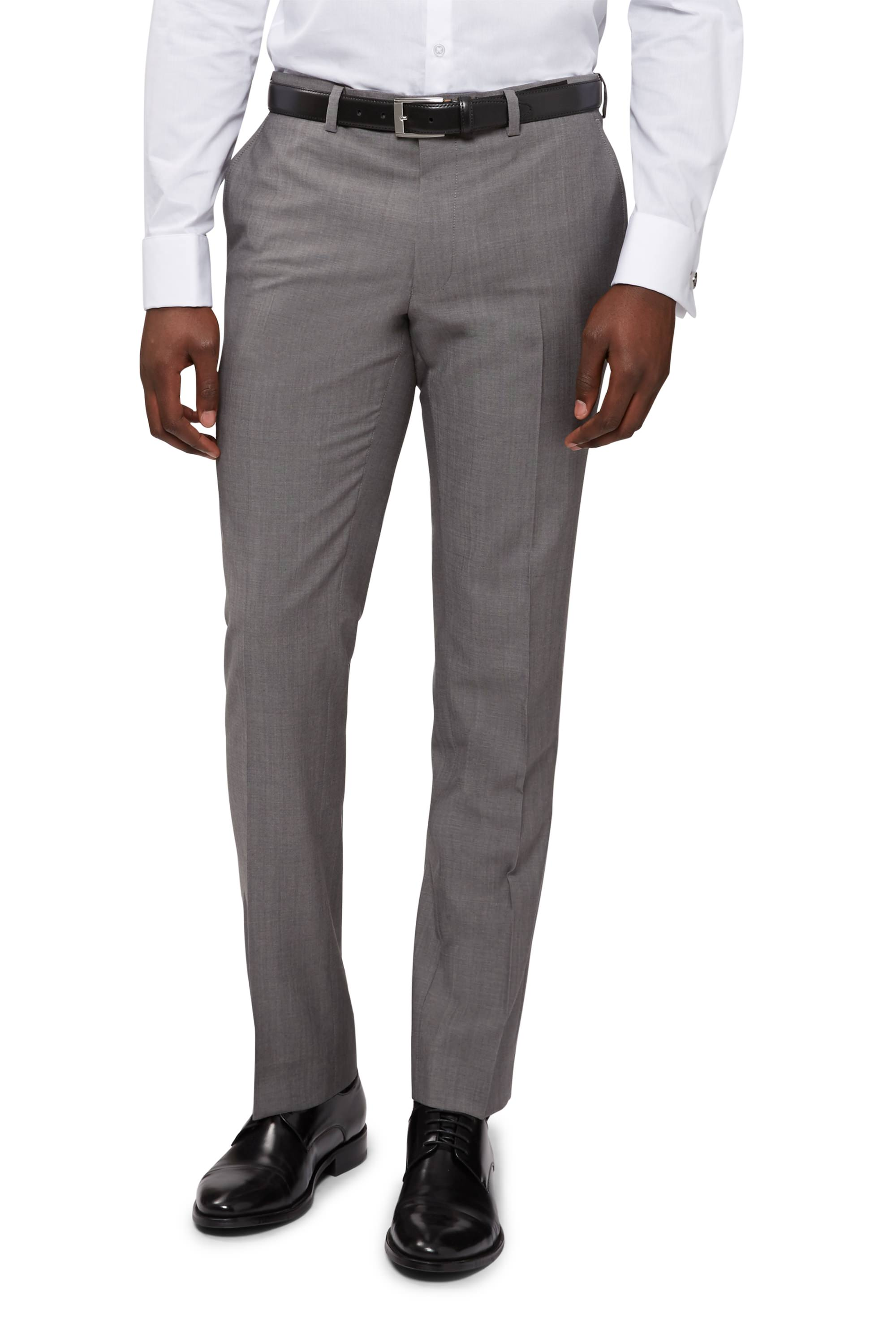 Men's suit pants made with a polyester fabric or blend are a durable, wrinkle-resistant option, which means no ironing. Polyester is a flexible material that's resistant to shrinking, as well. The fibers are strong and long lasting, so you can wear the pants for years to come.